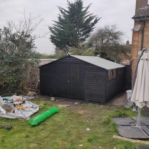 Black Wooden Shed in Garden