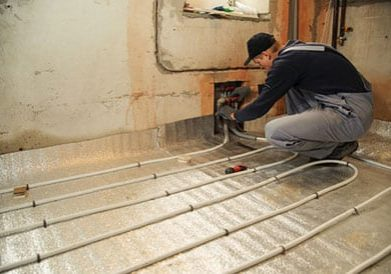 installation of insulation on wet underfloor heating